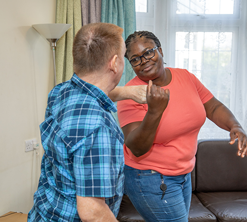 Carer and client dancing