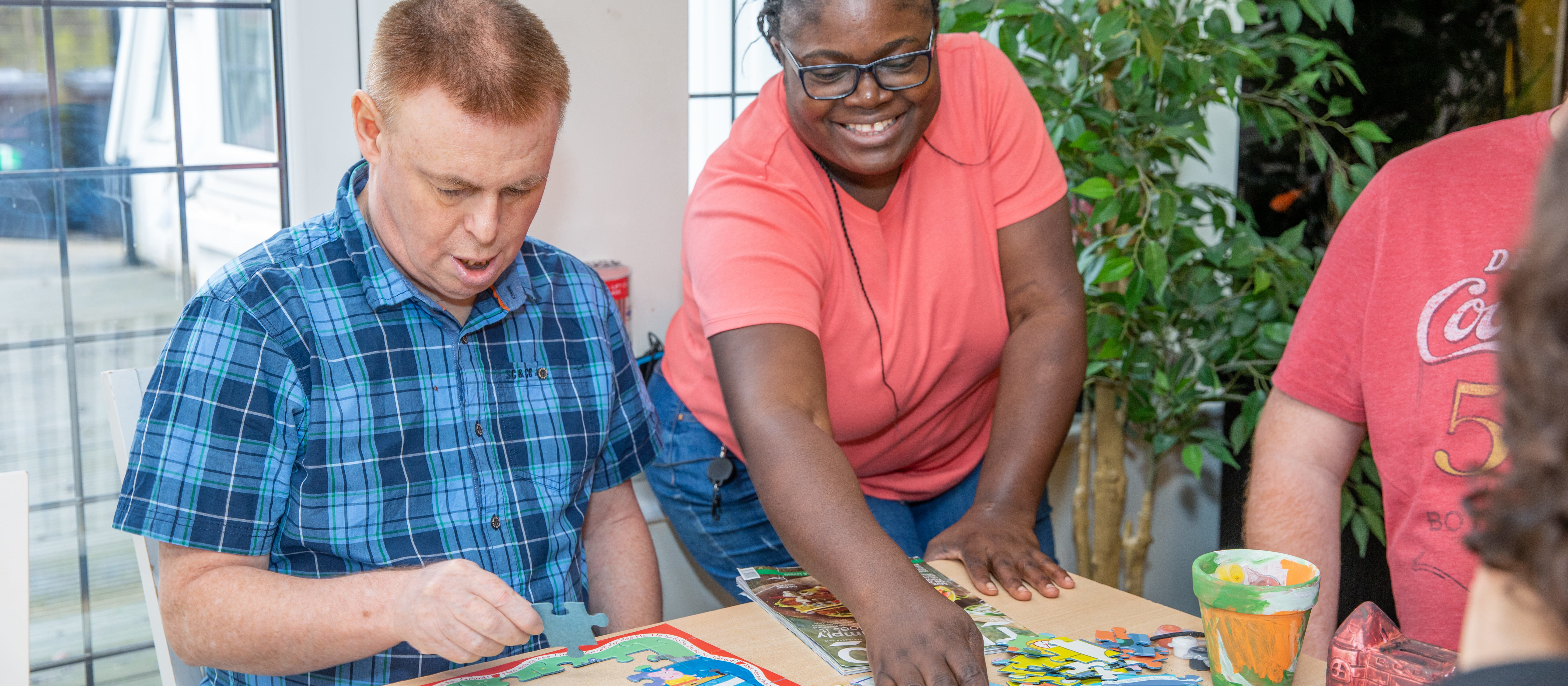 Carer and client completing puzzle together